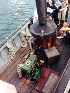 The African Queen is still steam powered - the steam boiler is in the center of the boat, and the steam engine is behind it, the workings fully exposed.