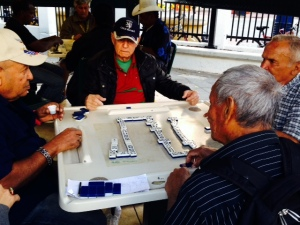 In the heart of Little Havana is Domino Park, a place where Cuban Americans gather at permanent tables to play dominos, seven days a week.