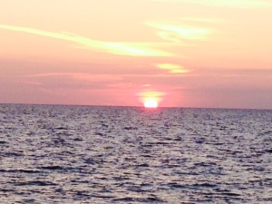 Due to the predicted winds, we pulled up the anchor after dinner at dusk and headed for the harbor in Grand Cay. On the way, we saw this amazing sunset as the sun seemingly disappeared into the sea.