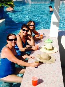 Enjoying a Happy Hour drink at the pool/tiki bar...