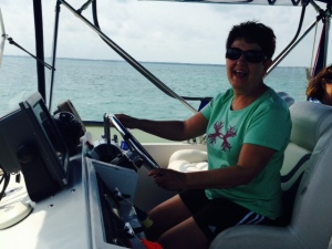 Louise at the helm on our way to Hopetown -
