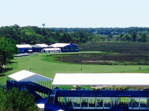 This is a view from the top of the lighthouse of the 18th hole of the PGA Tour course. The green is directly in front of the buildings in the background and the green is behind the grandstand (the white roof) in the foreground of the picture. I'm told that golfers take aim at the lighthouse on their first drive from the tee. TV crews set up their cameras on the lighthouse where I stood to take this picture to film the golfers playing the 18th hole in the PGA Tournament.