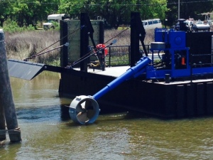 "This ""bow thruster"" is attached to one end of the swing bridge. To put it in place so vehicles can cross, the ""floating bridge"" is untied, the bow thruster is lowered into the water and activated, swinging the ""bow"" of the bridge into the river."