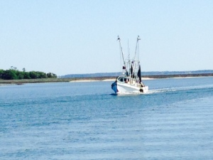 A shrimper on its way in port -