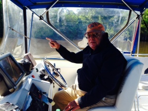 Tom Thurston piloting the Joint Adventure up the ICW