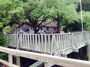 The single marina building, with a deck overlooking the bayou.