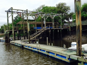The marina dock - tides run up to 9 feet. The superstructure holds an overhead crane used to pick fishing boats off their trailers and lower them into the water- and raise them back up upon return.