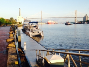 The Joint Adventure docked immediately adjacent to the Hyatt Hotel in the center of the downtown Historic District. The 185 foot high iconic cable-stayed bridge in the background was built in the 1990's to replace a 139 foot high bridge in order to allow larger ships to enter the port.