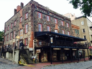 A historic mercantile building along the River Street on the waterfront, the first floor of which now houses retail stores. The Historic District in Savannah is the largest of any city in the US.