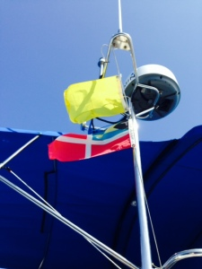 The yellow quarantine flag and the Bahamas courtesy flag on the Joint Adventure as we entered the West End