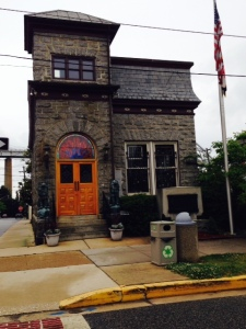 Originally a bank constructed in the early 1800's, this building has been fully restored and now houses a stained glass window shop with a huge stained glass window displayed inside.