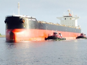 We had to move to the side of the channel as these tugs maneuvered this massive freighter towards the harbor