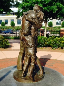 This is a statue along the waterfront of a soldier returning home to his family -