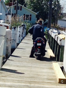 The owner of Parks Marina is Milton Parks - he is 84 years old and gets from his house to the marina on this motorcycle, which he drives with abandon on the 4' wide docks.