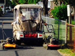 Ingenuity reigns on Tangier Island - the two women on the golf cart have a landscape maintenance business - they are moving these two lawn mowers to their next job.