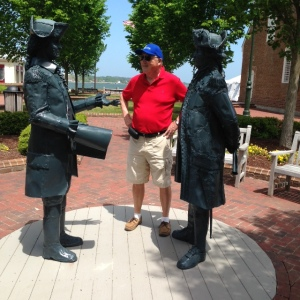 This is a statue of George Washington and his French counterpart at the Battle of Yorktown.  Tom is asking directions to the trolley stop....