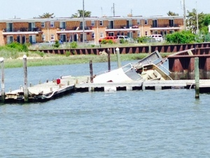 Most of the visual damage from Hurricane Sandy 2 1/2 years ago has been demolished or removed but this sunken boat and damaged dock was a reminder of the massive destruction that New Jersey and New York City endured.