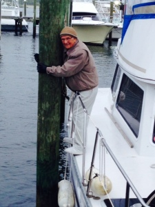 Hoffman's Marina in Manasquan is a short distance from the inlet, so there is a powerful current that makes docking maneuvers quite tricky, particularly when there is also a strong crosswind. My Dad is holding the boat in place while we untie the myriad of lines.