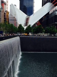 A small portion of the 9/11 Memorial. The white structure in the background is a sculpture still under construction, being built from remnants of the old World Trade Center towers.