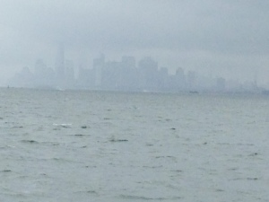 The Manhattan skyline emerges from the fog as we proceed up the Hudson River