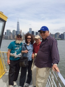 Returning to the Joint Adventure on the ferry, with the Manhattan skyline and the Freedom Tower in the background. From left to right:  Jim K, Kate, Hank, and Tom.